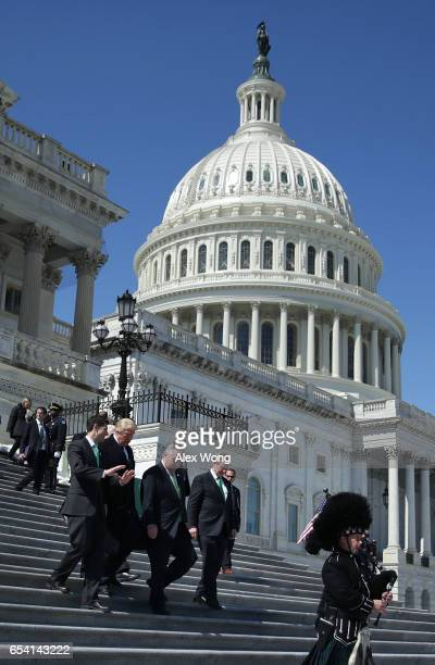 S President Donald Trump House Speaker Paul Ryan Irish Taoisech Enda Kenny and Rep Peter King walk down the House east front steps after the annual...
