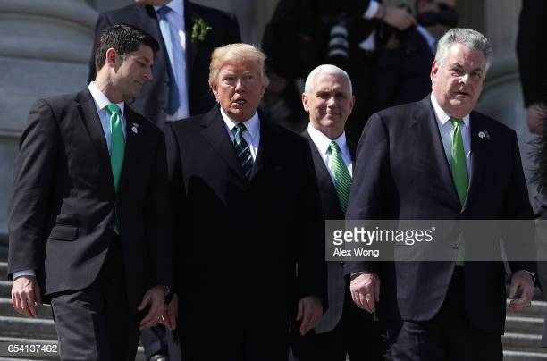 S President Donald Trump House Speaker Paul Ryan Vice President Mike Pence and Rep Peter King walk down the House east front steps after the annual...