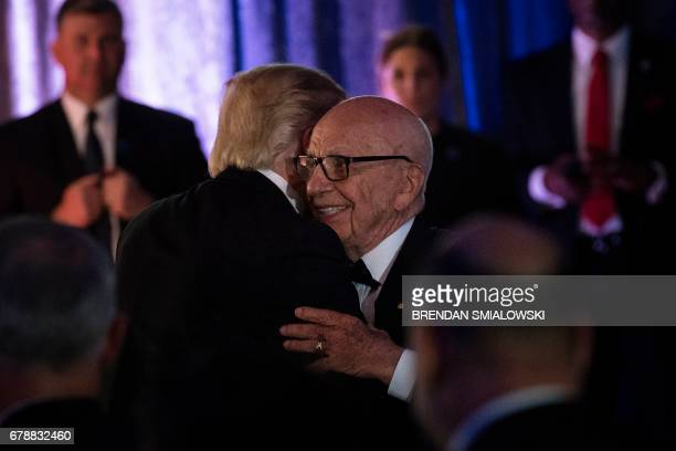 US President Donald Trump is embraced by Rupert Murdoch Executive Chairman of News Corp during a dinner to commemorate the 75th anniversary of the...