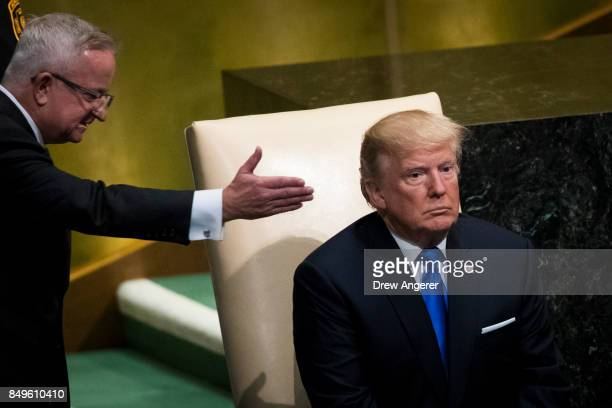 S President Donald Trump is escorted by a protocol official as he prepares to take the lectern to address the United Nations General Assembly at UN...