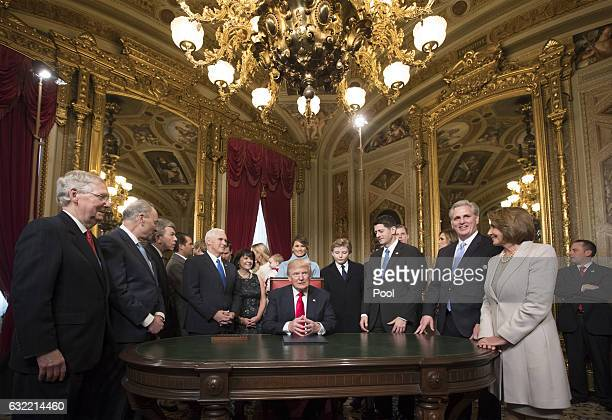 President Donald Trump is joined by the Congressional leadership and his family as he formally signs his cabinet nominations into law in the...