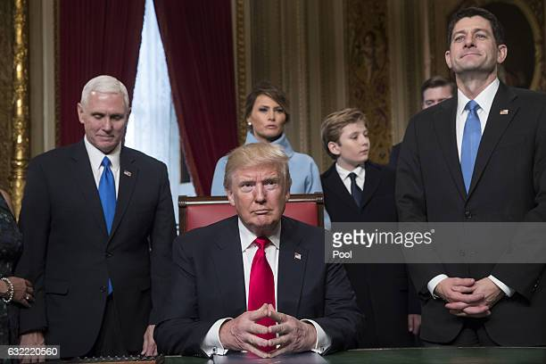President Donald Trump is joined by the Congressional leadership and his family before formally signing his cabinet nominations into law in the...