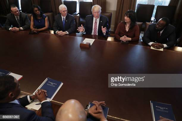 US President Donald Trump is joined by Vice President Mike Pence White House Director of Communications for the Office of Public Engagement and...