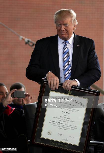 S President Donald Trump is presented with a Doctorate of Laws during the commencement at Liberty University May 13 2017 in Lynchburg Virginia...