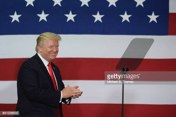 S President Donald Trump is received prior to remarks during an appearance at the Loren Cook Company on August 30 2017 in Springfield Missouri...