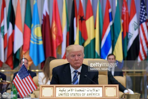 US President Donald Trump is seated during the Arab Islamic American Summit at the King Abdulaziz Conference Center in Riyadh on May 21 2017 / AFP...