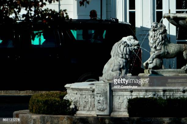 US President Donald Trump is seen in an armored vehicle while leaving the Trump National Golf Club on October 22 in Sterling Virginia / AFP PHOTO /...