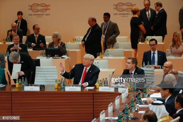 US president Donald Trump is waving at Indian PM Narendra Modi ahead of the third plenary session of the G20 summit in Hamburg Germany on 8 July 2017