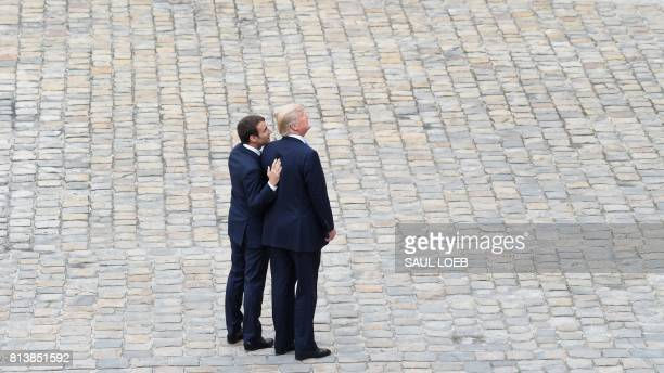 President Donald Trump is welcomed by French President Emmanuel Macron during a welcome ceremony at Les Invalides in Paris on July 13 2017 Donald...