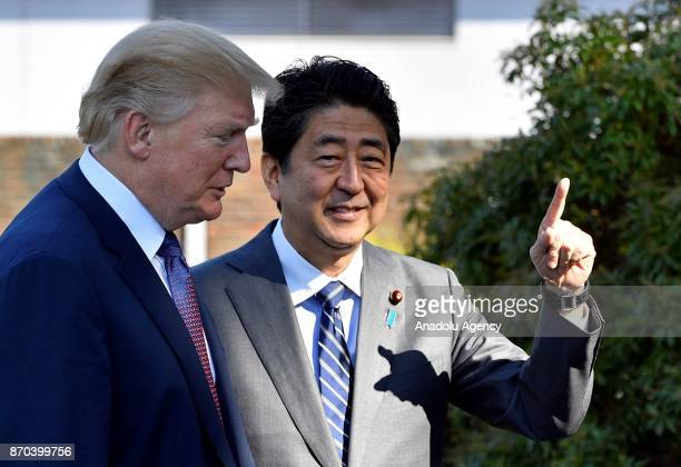 S President Donald Trump is welcomed by Japanese Prime Minister Shinzo Abe upon his arrival at the Kasumigaseki Country Club in Kawagoe near Tokyo...