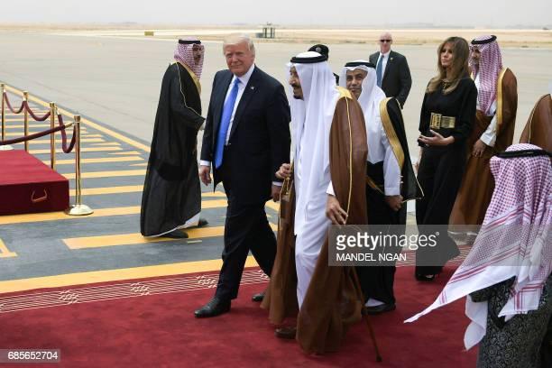 US President Donald Trump is welcomed by Saudi King Salman bin Abdulaziz alSaud upon arrival at King Khalid International Airport in Riyadh on May 20...