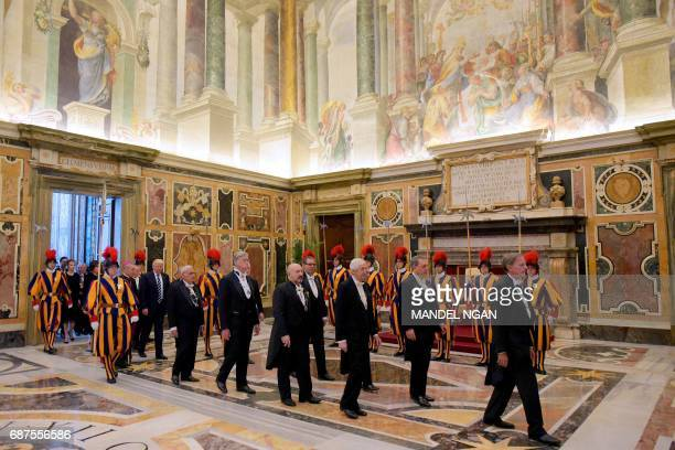 US President Donald Trump is welcomed by the prefect of the papal household Georg Gaenswein as he arrives at the Vatican for a private audience with...