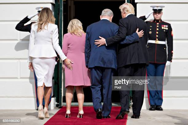 US President Donald Trump Israeli Prime Minister Benjamin Netanyahu and their wives first lady Melania Trump and Sara Netanyahu walk into the White...