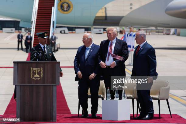 US President Donald Trump Israel's Prime Minister Benjamin Netanyahu and Israel's President Reuven Rivlin stand next to each other during a welcoming...