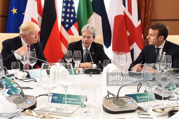 US President Donald Trump Italian Prime Minister Paolo Gentiloni and French President Emmanuel Macron attend a working lunch during the Summit of the...