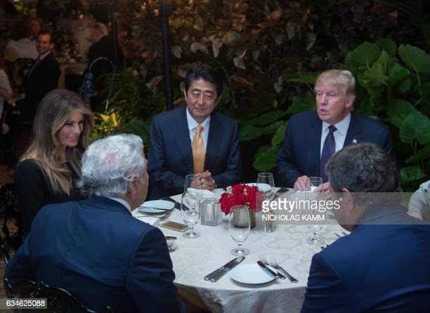 US President Donald Trump Japanese Prime Minister Shinzo Abe US First Lady Melania Trump and Robert Kraft owner of the New England Patriots sit down...