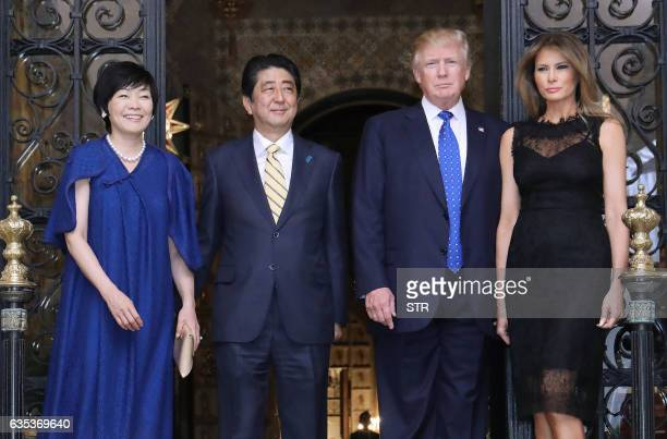 US President Donald Trump Japans Prime Minister Shinzo Abe Trump's wife Melania and Abe's wife Akie pose for photograpers before a dinner party in...
