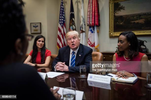 President Donald Trump joined by Dyan Gibbens of Trumbull Unmanned left and Jessica Johnson of Johnson Security Bureau right participates in a...