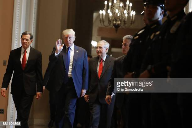 S President Donald Trump joins Sen John Barrasso and Senate Majority Leader Mitch McConnell as they head into the weekly Senate Republican Policy...