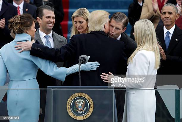 President Donald Trump kisses his son Eric Trump after his inauguration on the West Front of the US Capitol on January 20 2017 in Washington DC In...