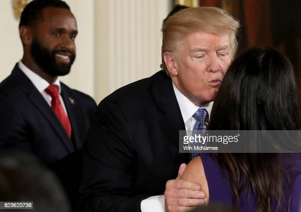 S President Donald Trump kisses Jennifer Scalise wife of Rep Steve Scalise during an event in the East Room of the White House recognizing the first...