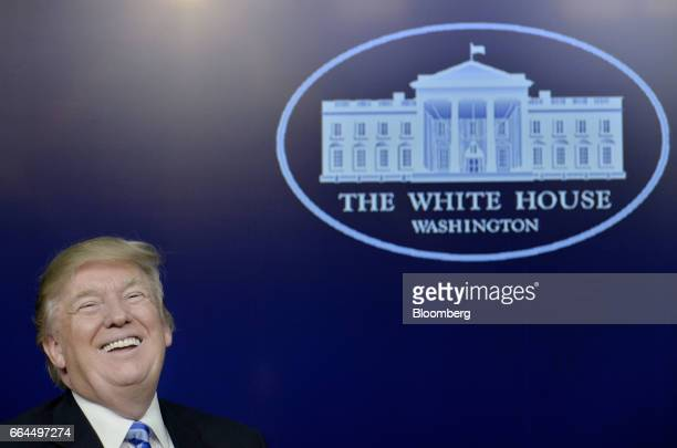US President Donald Trump laughs during a town hall meeting with executives on the America business climate in the South Court Auditorium of the...