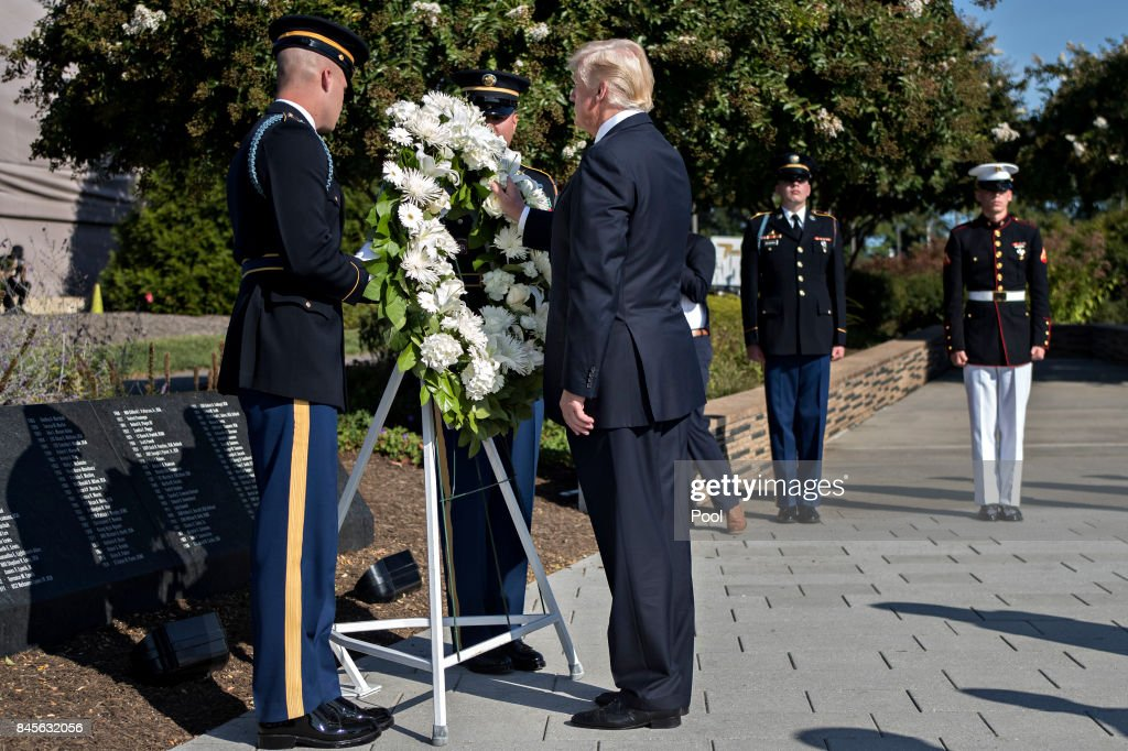 U.S. President Donald Trump lays a wreath at a ceremony commemorating the September 11, 2001 terrorist attacks at the Pentagon September 11, 2017 in Washington, D.C. Trump was presiding over his first 9/11 commemoration on the 16th anniversary of the terrorist attacks that killed nearly 3,000 people when hijackers flew commercial airplanes into New York's World Trade Center, the Pentagon and a field near Shanksville, Pennsylvania.