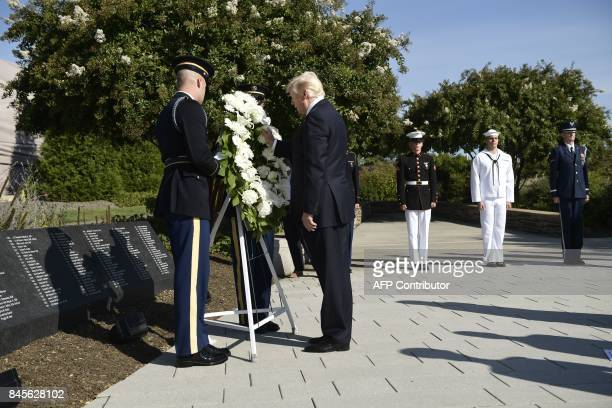 US President Donald Trump lays a wreath at the Pentagon's 9/11 Memorial in Washington DC on September 11 during the 16th anniversary of 9/11 / AFP...