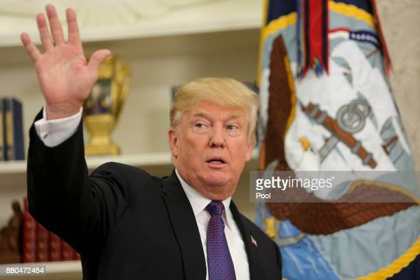 US President Donald Trump leaves after an event honoring members of the Native American code talkers in the Oval Office of the White House on...