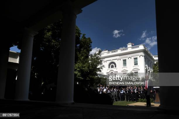 US President Donald Trump leaves after announcing his decision to withdraw the US from the Paris Climate Accords in the Rose Garden of the White...