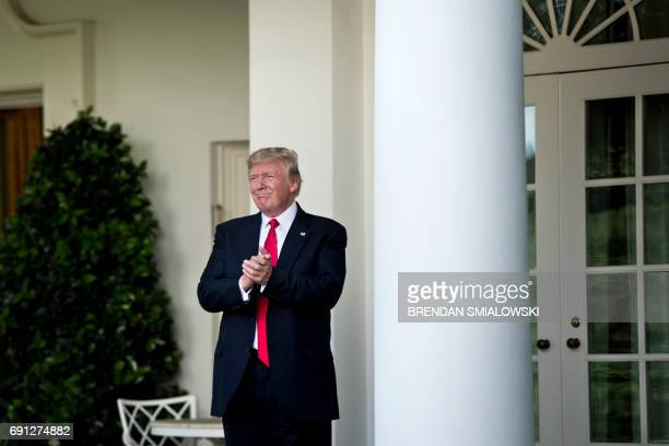 US President Donald Trump leaves after announcing the US will withdraw from the Paris accord in the Rose Garden of the White House on June 1 2017 in...