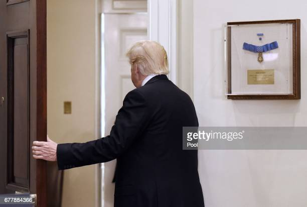 President Donald Trump leaves after giving a joint statement with President Mahmoud Abbas of the Palestinian Authority in the Roosevelt Room of the...