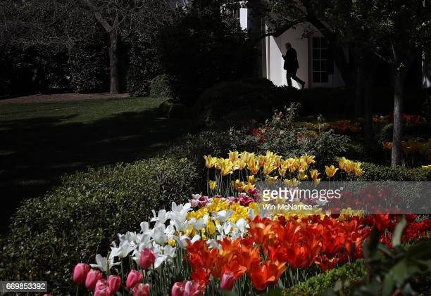S President Donald Trump leaves the Oval Office on his way to a waiting Marine One helicopter April 18 2017 in Washington DC Trump is scheduled to...