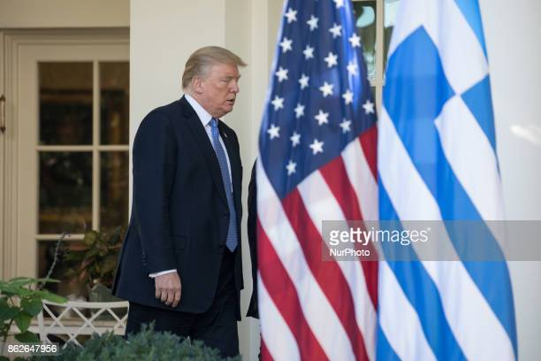 US President Donald Trump leaves the Oval Office to walk to the Rose Garden of the White House for his joint press conference with Prime Minister...