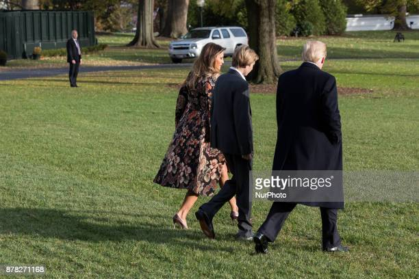 President Donald Trump leaves the White House with First Lady Melania Trump and son Barron Trump as they depart for the Thanksgiving Holiday from the...