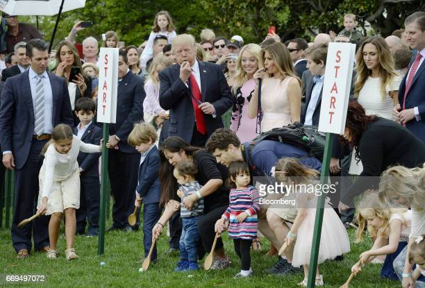 US President Donald Trump left and First Lady Melania Trump right blow a whistle to start the annual Easter Egg Roll on the South Lawn of the White...