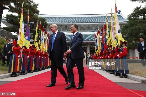 US President Donald Trump left and South Korean President Moon Jaein walk past an honor guard during a welcoming ceremony at the presidential Blue...