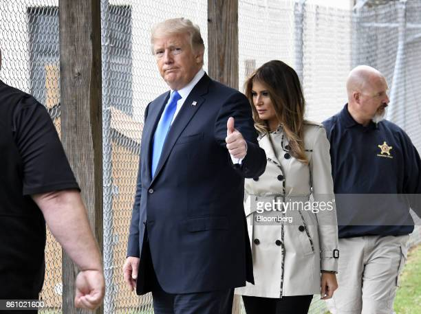 US President Donald Trump left gestures while walking with US First Lady Melania Trump during a tour of the US Secret Service James J Rowley Training...