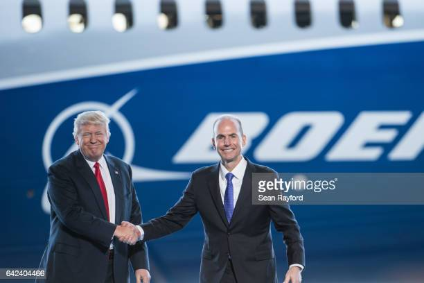 S President Donald Trump left is introduced by Boeing's chief executive officer Dennis Muilenburg during the debut event for the Dreamliner 78710 at...