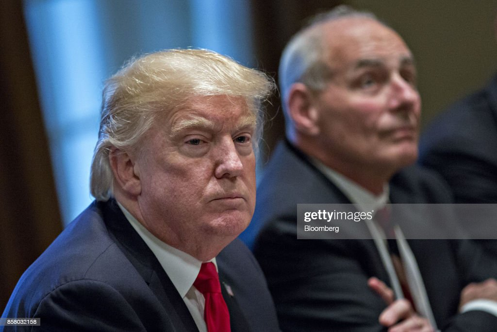 U.S. President Donald Trump, left, pauses after speaking during a briefing with senior military leaders in the Cabinet Room of the White House in Washington, D.C., U.S., on Thursday, Oct. 5, 2017. Defense Secretary Jim Mattis said this week the U.S. and allies are holding the line against the Taliban in Afghanistan as forecasts of a significant offensive by the militants remain unfulfilled. Photographer: Andrew Harrer/Bloomberg via Getty Images