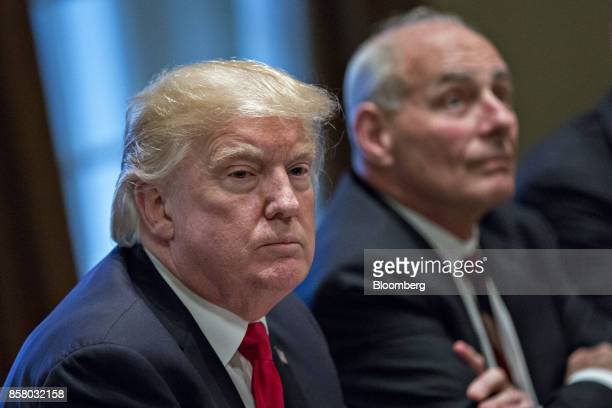 US President Donald Trump left pauses after speaking during a briefing with senior military leaders in the Cabinet Room of the White House in...
