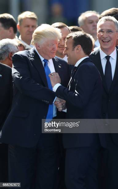 US President Donald Trump left shakes hands with Emmanuel Macron France's president during a summit of world leaders at the North Atlantic Treaty...