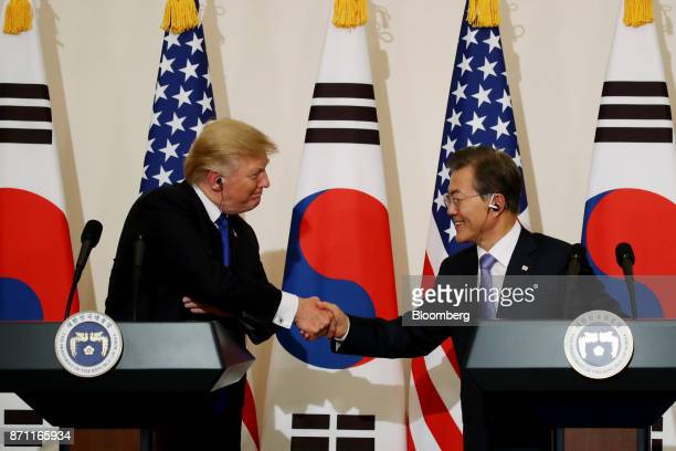 US President Donald Trump left shakes hands with Moon Jaein South Korea's president during a news conference at the presidential Blue House in Seoul...