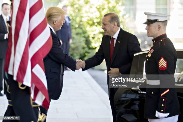 US President Donald Trump left shakes hands with Recep Tayyip Erdogan Turkey's president at the West Wing of the White House in Washington DC US on...