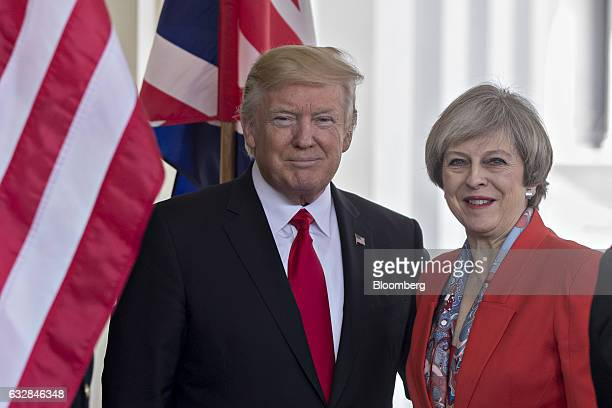 US President Donald Trump left stands with Theresa May UK prime minister while arriving to the West Wing of the White House in Washington DC US on...
