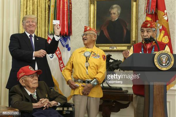 US President Donald Trump left stands with World War II veterans during an event honoring Native American 'Code Talkers' inside the Oval Officer of...
