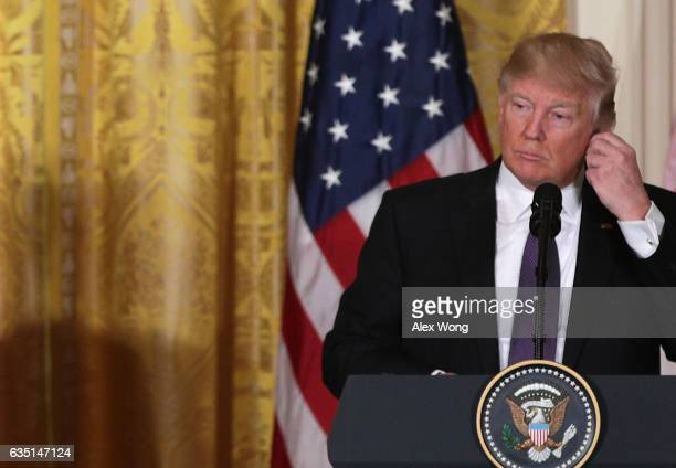 S President Donald Trump listens as he participates in a joint news conference with Canadian Prime Minister Justin Trudeau in the East Room of the...
