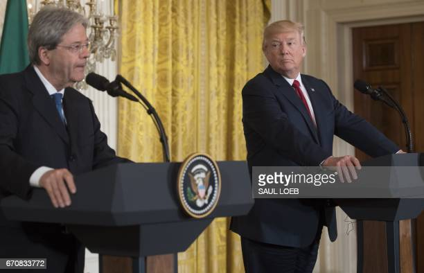 US President Donald Trump listens as Italian Prime Minister Paolo Gentiloni speaks during a press conference in the East Room at the White House in...