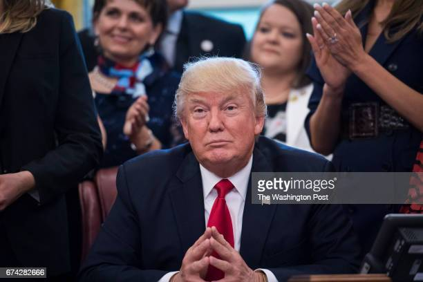 President Donald Trump listens at a National Teacher of the Year event in the Oval Office of the White House in Washington DC on Wednesday April 26...