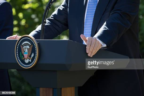 US President Donald Trump listens at his joint press conference with Prime Minister Alexis Tsipras of Greece in the Rose Garden of the White House on...